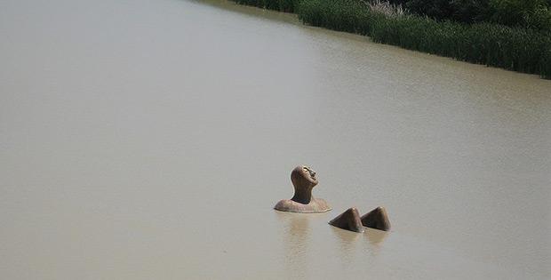 Sunbathing man in Guadalquivir river, Cordoba, Spain