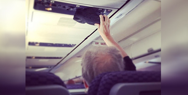 Weird plane passenger drying his shoe