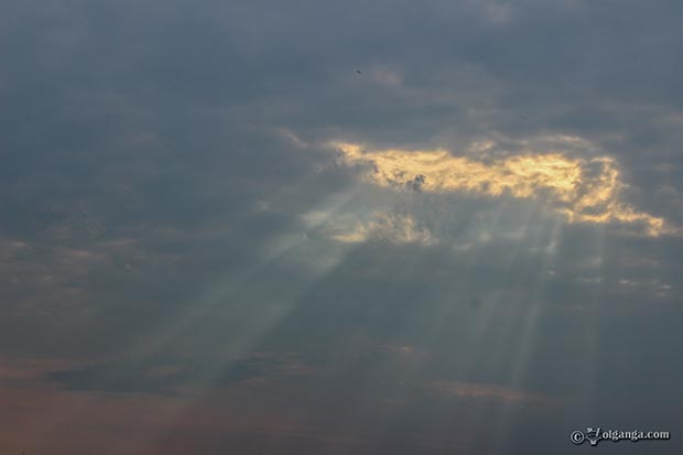 Sky HD wallpapers. Heavenly light struggling through thick clouds.