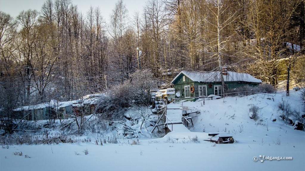 Wooden house in the snow hill forest
